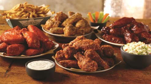 Product image for Wingstop. Casselberry FREE regular seasoned fries with purchase of 20 wings