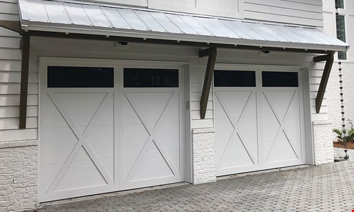 Product image for America's Garage Doors, llc $280 Garage Door Overhaul Includes two springs and rollers.