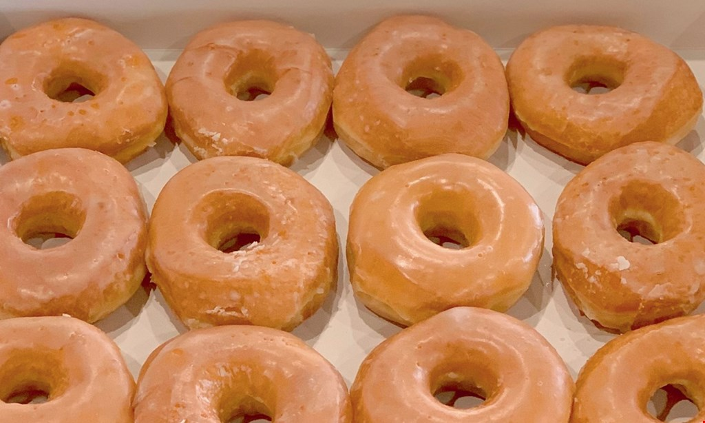 Product image for Gerald's Donuts & Burgers $1 OFF any dozen donuts.