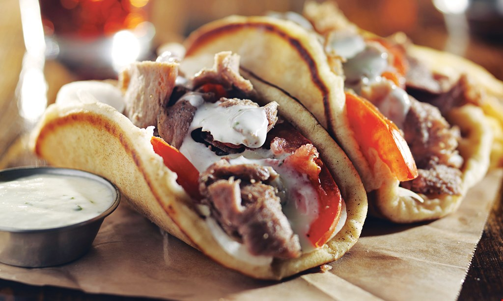 Product image for Greek Village Restaurant & Catering $39.95 4 Gyros, 1 Large Salad or French Fries, includes pitas, our Greek salad dressing, yogurt sauce, and dessert of the day - feeds 4-5