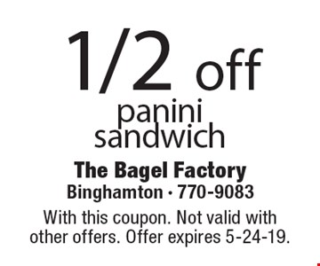 1/2 off panini sandwich. With this coupon. Not valid with  other offers. Offer expires 5-24-19.