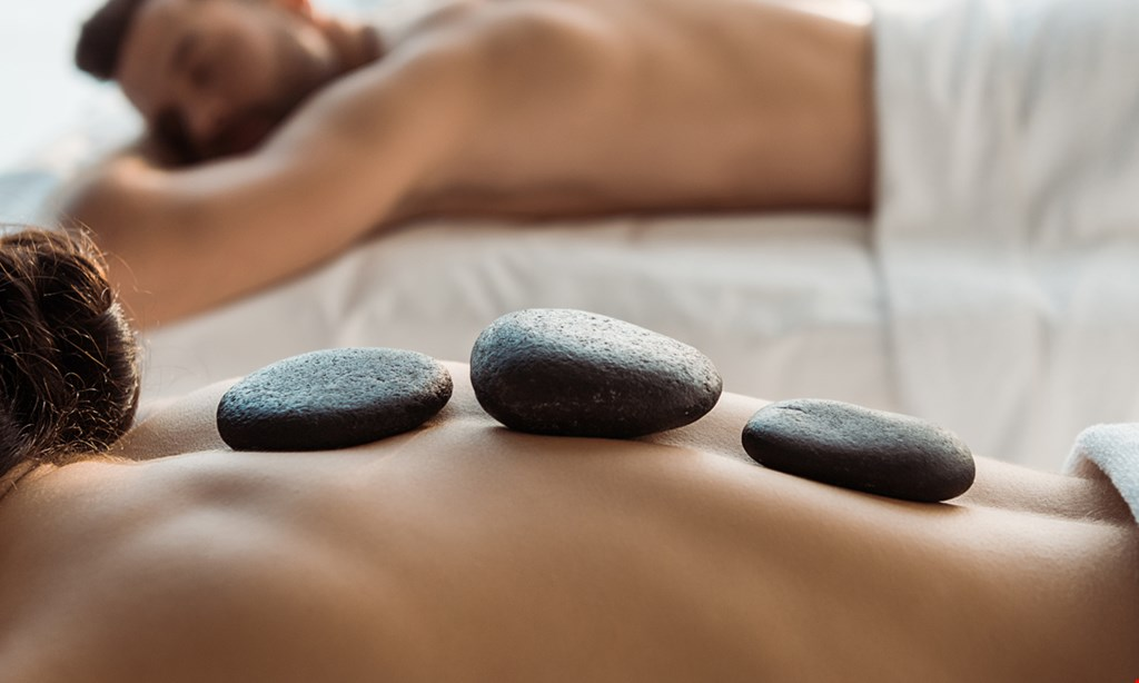 Product image for The Secret Garden Wholistic Inc $82.50 for a One Hour Couples Massage with Himalayan Salt Stones or Classic Stones ($165 value)